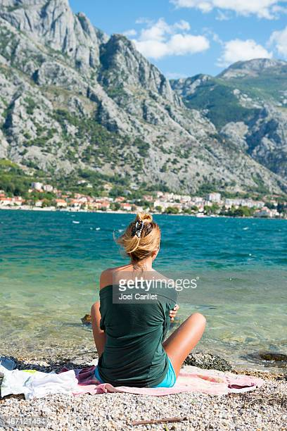 Woman at beach on Kotor Bay in Montenegro