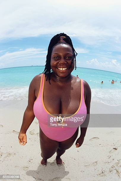 woman at beach - women with large breast stock pictures, royalty-free photos & images