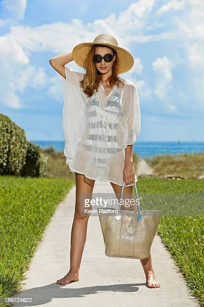 woman at beach wearing sunglasses