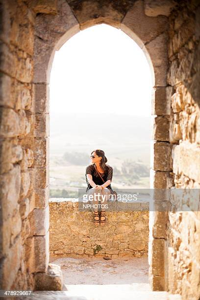 Woman at Óbidos castle wall