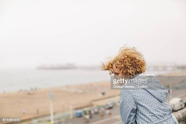 woman at brighton pier looking at beach against clear sky - bortes stock pictures, royalty-free photos & images