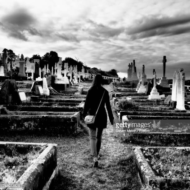 Woman At Cemetery Against Sky