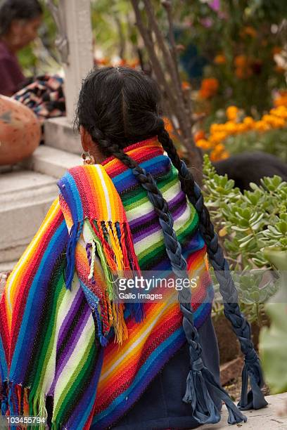 woman at cemetery during day of the dead (dias de los muertos) celebration, teotitlan del valle, oaxaca province, mexico - sugar skull stock photos and pictures