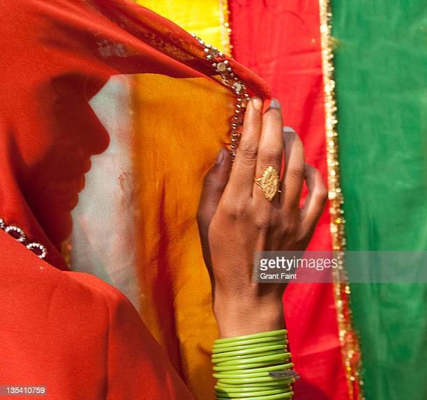 Woman at cloth market.