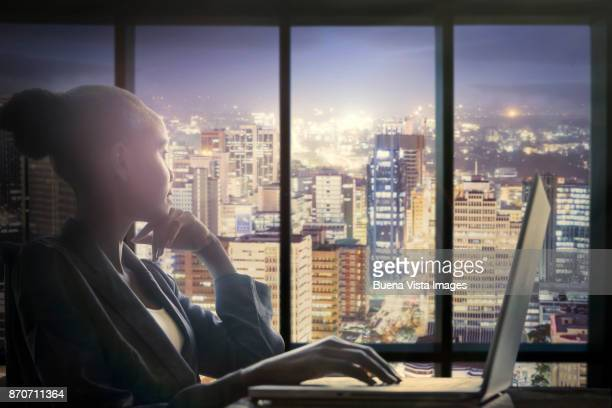 woman at computer watching city - nairobi stock pictures, royalty-free photos & images