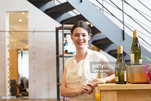 Woman at counter in wine shop