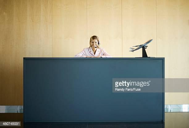 Woman at Customer Service Counter