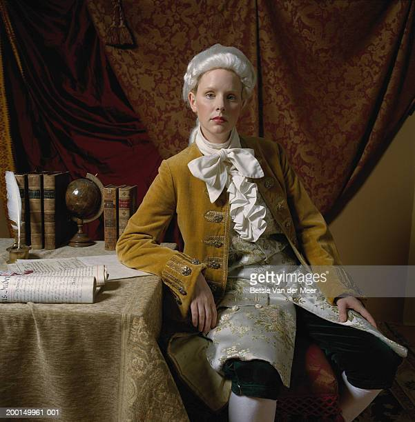 woman at desk, in male costume from regency era, portrait - elizabethan collar stock photos and pictures