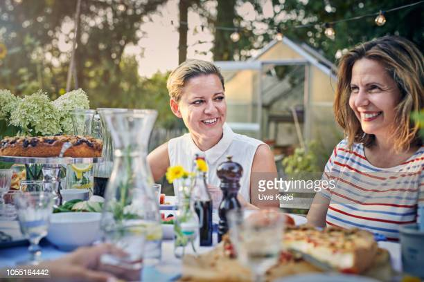 Woman at dinner table in garden