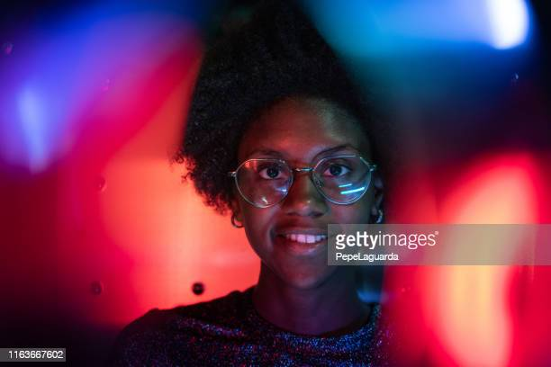 woman at disco club with colorful light effects - street light stock pictures, royalty-free photos & images