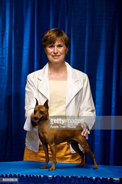 woman at dog confirmation  - dog show stock pictures, royalty-free photos & images
