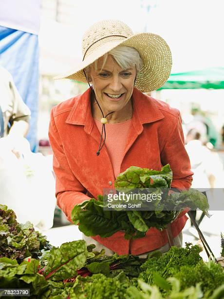 woman at farmers market - one senior woman only stock pictures, royalty-free photos & images