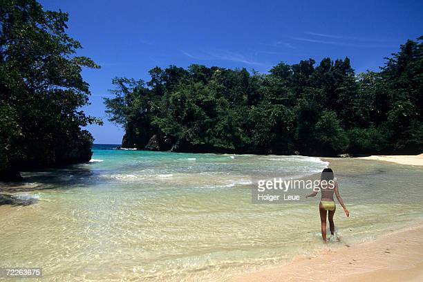 woman at frenchman's cove beach, port antonio, jamaica - bay of water stock pictures, royalty-free photos & images