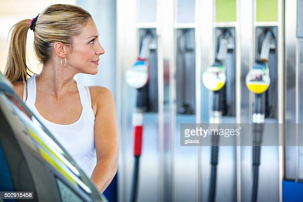 Woman at gas station.