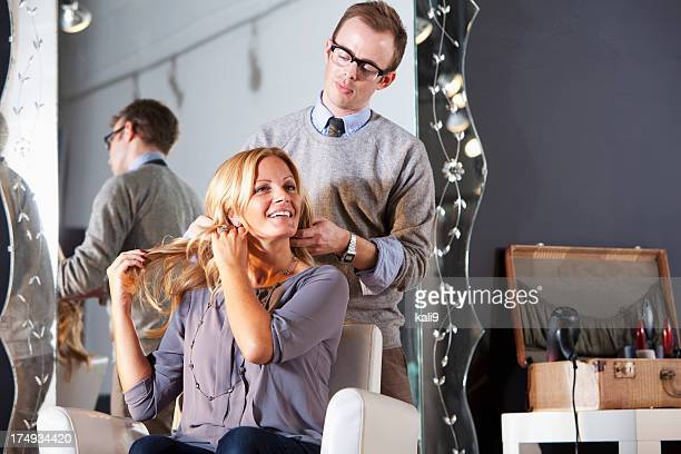woman at hair salon with male hairdresser - mid adult women stock pictures, royalty-free photos & images