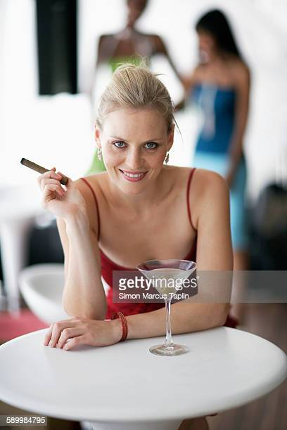 woman at happy hour - beautiful women smoking cigars stock photos and pictures