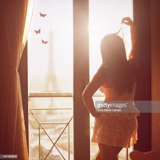 woman at her window in paris - women in slips stock pictures, royalty-free photos & images