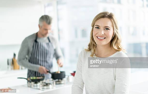 Woman at home cooking with her partners