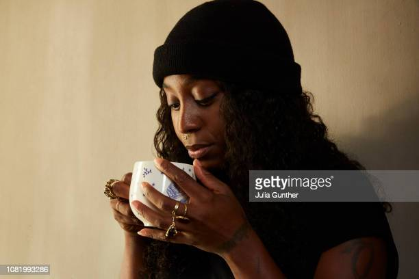 Woman at home drinking hot beverage