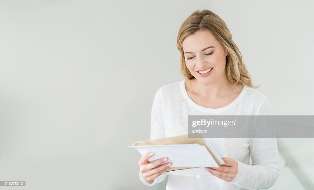 Woman at home getting the mail : Stock Photo