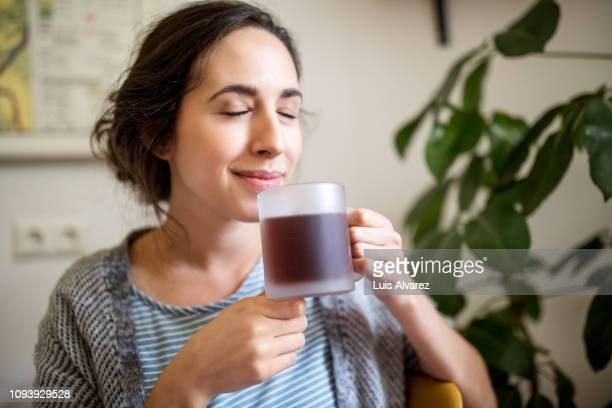 woman at home having coffee in morning - drinking stock pictures, royalty-free photos & images