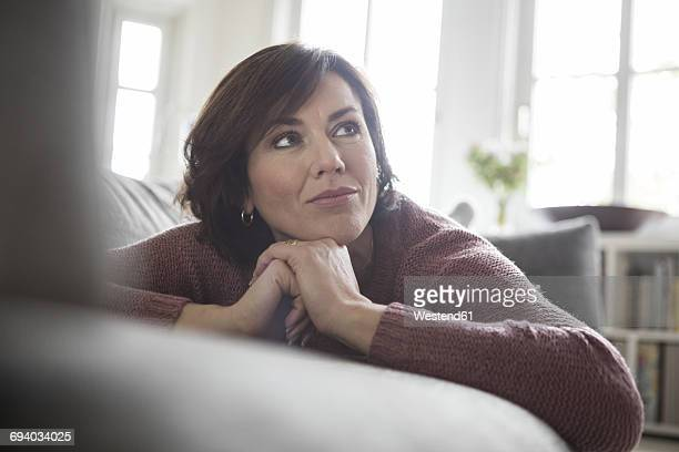Woman at home lying on the sofa