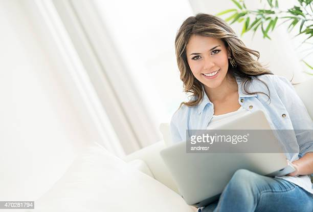 Woman at home on a laptop computer