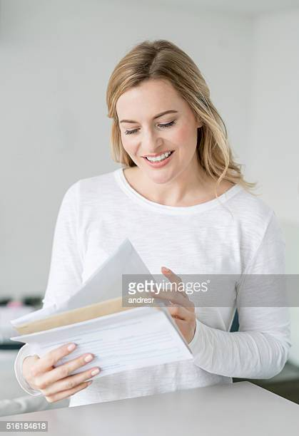Woman at home reading the mail
