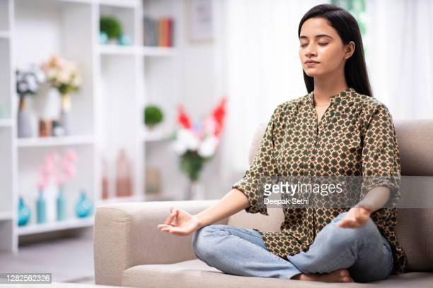 woman at home sofa sitting - stock photo - wellbeing stock pictures, royalty-free photos & images