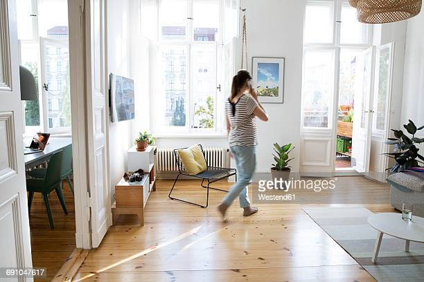 Woman at home talking on cell phone