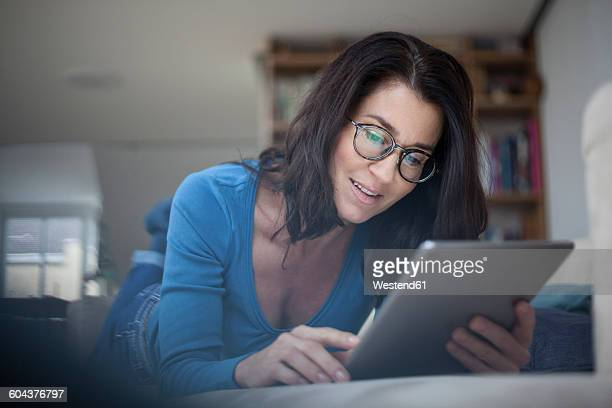 Woman at home using digital tablet