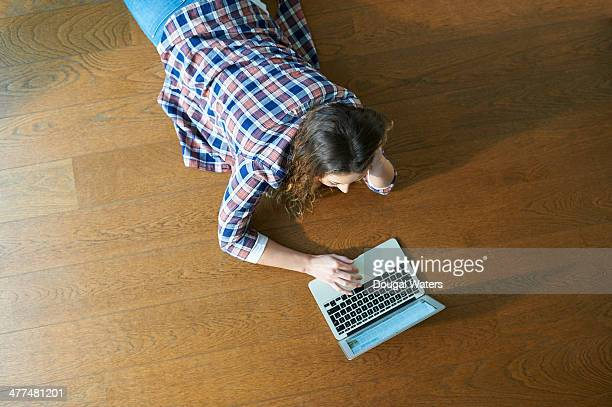 Woman at home using laptop.