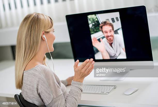 woman at home video chatting with her boyfriend - human body part stock pictures, royalty-free photos & images
