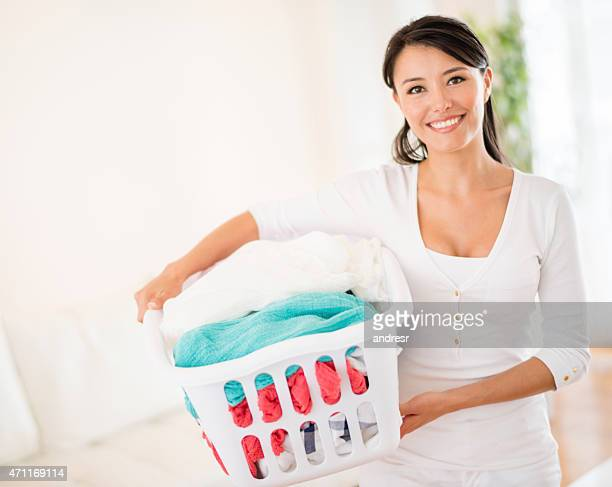 Woman at home with a laundry basket