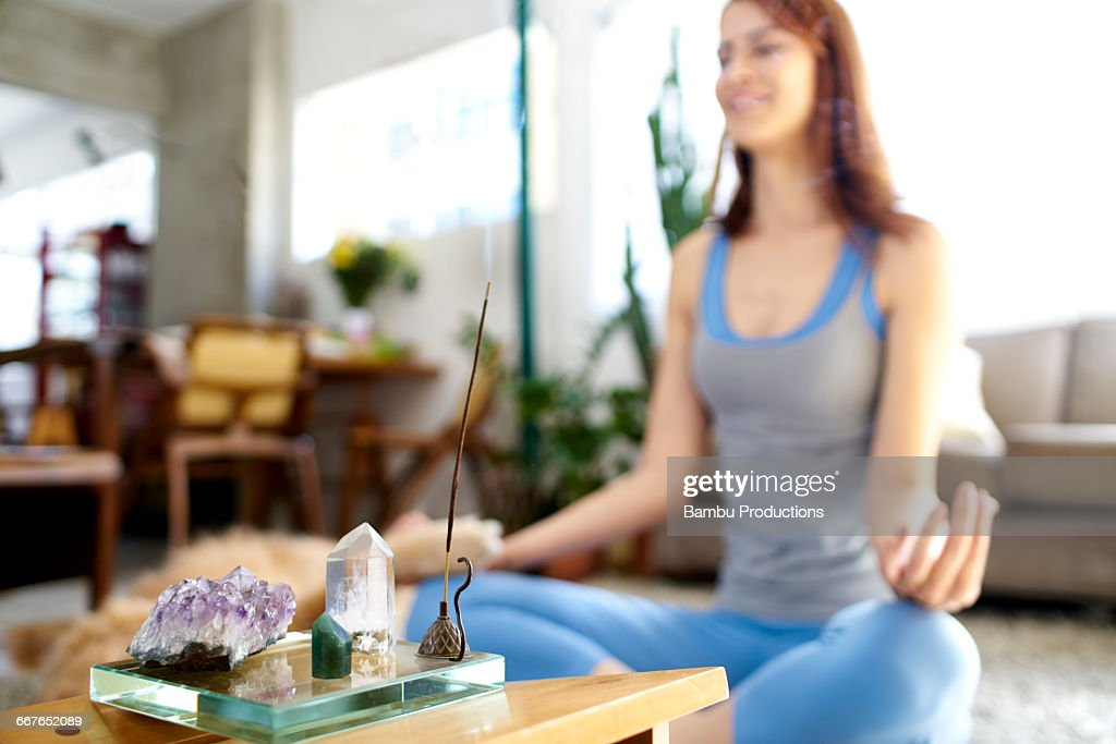 Woman at home with incense and crystals : Stock Photo