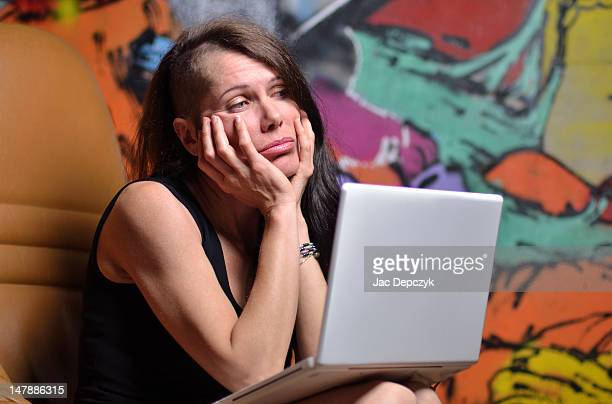 woman at home with laptop, sad or bored - depczyk stock pictures, royalty-free photos & images