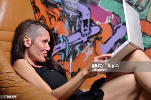 woman at home with laptop, smiling - depczyk stock pictures, royalty-free photos & images