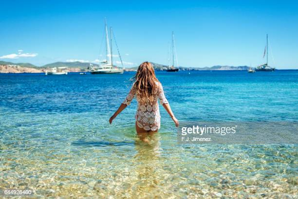 woman at llentrisca beach in ibiza - insel ibiza stock-fotos und bilder