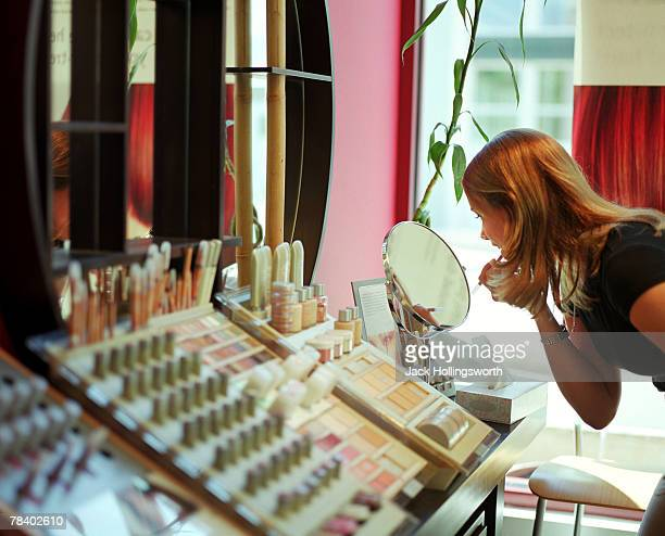 Woman at makeup counter