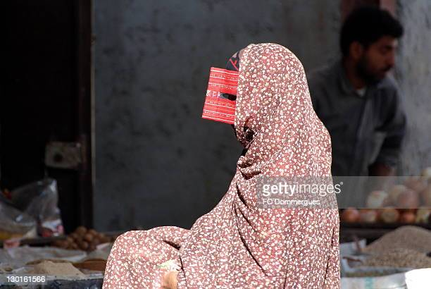 woman at market - incidental people stock pictures, royalty-free photos & images