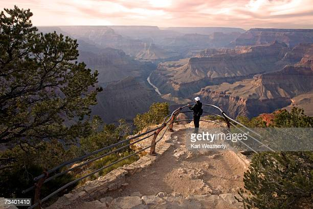 Woman at Observation Point, Grand Canyon, Arizona, USA, side view