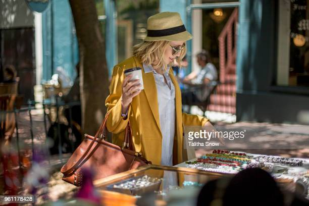 woman at outdoor market stall, cape town, south africa - mid adult women stock pictures, royalty-free photos & images