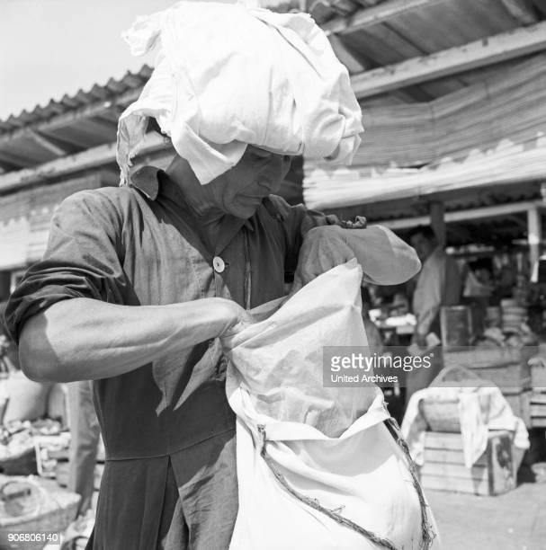 Woman at Paraguay mart in Posadas Argentina 1964