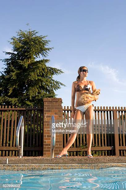 Woman at Pool with Toy Dog