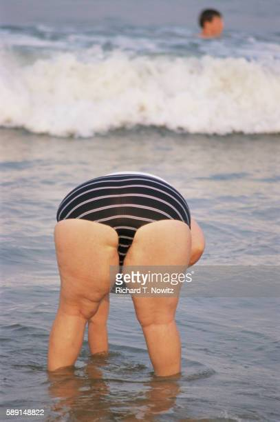 woman at rehoboth beach - fat woman at beach stock pictures, royalty-free photos & images