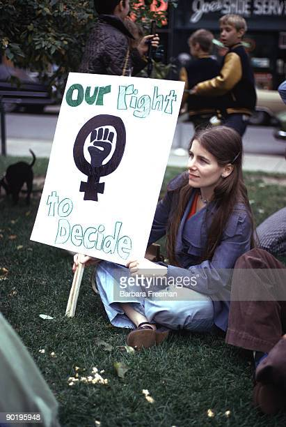 Woman at reproductive rights demonstration in Pittsburgh PA holds sign reading 'Our Right to Decide' in 1974