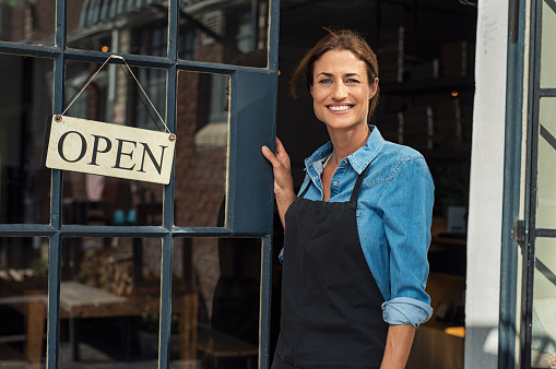 Woman at small business entrance 1040300704