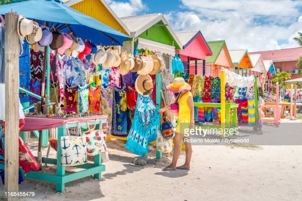 woman at souvenir market, long bay beach, antigua - antigua & barbuda stock pictures, royalty-free photos & images