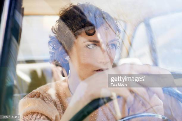 woman at steering wheel in car