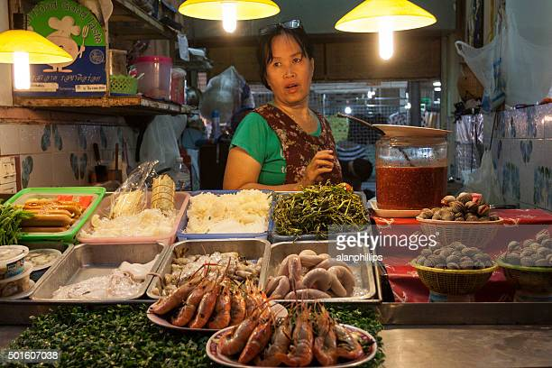Woman at street food stall in Chiang Rai Thailand